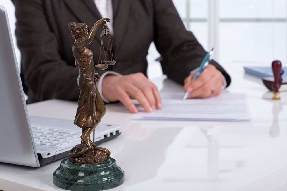 Business lawyer in manchester NH working on a contract.