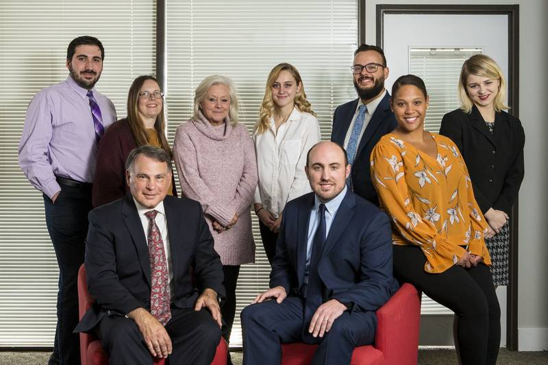 Group photo of our personal injury attorneys and paralegal administrative staff in our Manchester, NH office.
